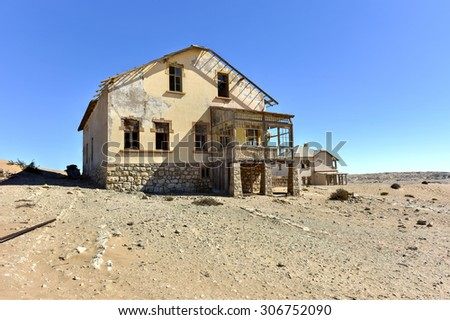The abandoned ghost diamond town of Kolmanskop in Namibia, which is slowly being swallowed by the desert.