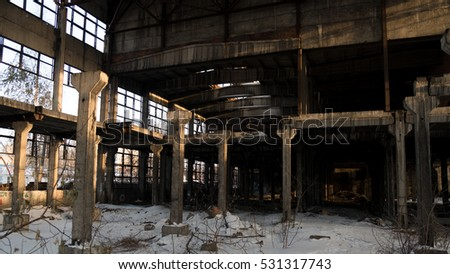 the abandoned ruins of an old workshop