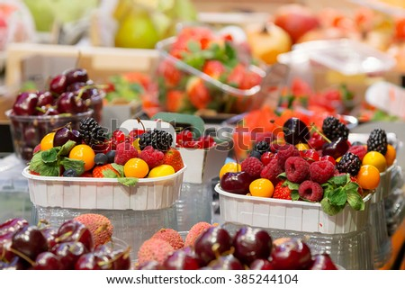 The absolute abundance of fresh vegetables, fruit, sausages, ham, meat, seafood, mushrooms in the European market. Barcelona, Spain, Market, Counters with food.  - stock photo