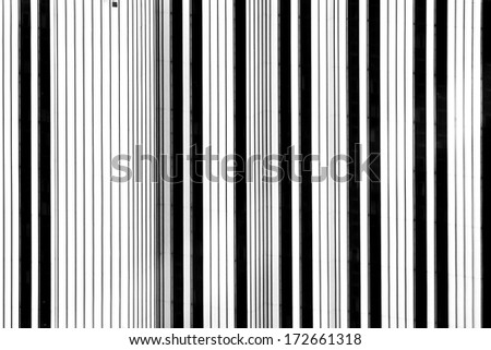 The abstract black and white photograph of the facade of a skyscraper / Black and white stripes