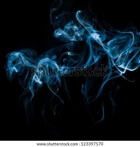 The abstract pattern made from smoke rising from an incense stick. - stock photo