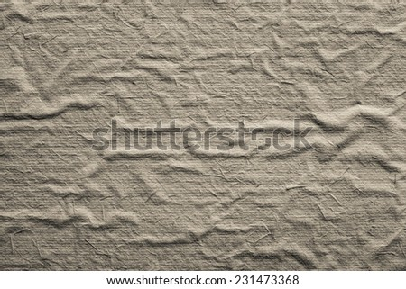the abstract textured rough background from the old crumpled paper of beige color