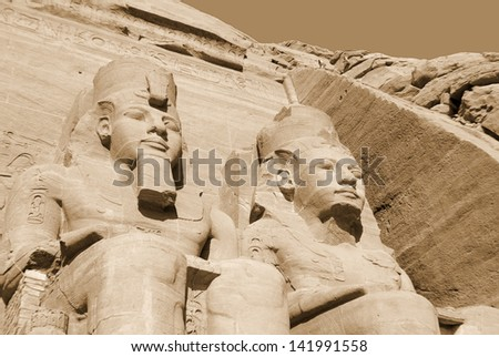 The Abu Simbel temples are two massive rock temples in Abu Simbel in Nubia, southern Egypt. They are situated on the western bank of Lake Nasser, about 230 km southwest of Aswan about 300 km by road. - stock photo