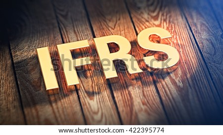 """The acronym """"IFRS"""" is lined with gold letters on wooden planks. 3D illustration image - stock photo"""