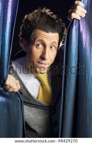 The actor is looking through  curtain - stock photo