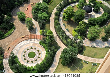 the aerial view of the curving footpath in a modern garden - Garden Design Birds Eye View