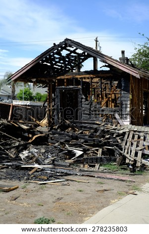 The aftermath of a recent residential fire leaves this house charred and uninhabitable.