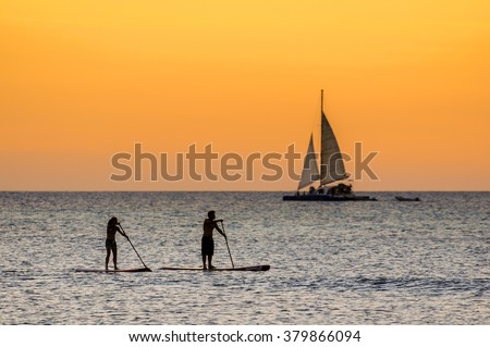 The afternoon is about to end while doing some paddle surf at  Hadicurari Beach, Aruba, Netherland Antilles.  - stock photo