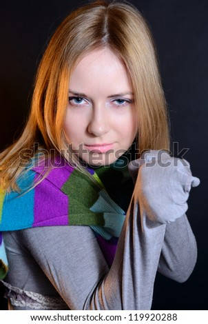 The aggressive girl with fists looks in cam - stock photo