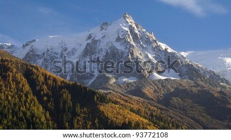 The Aiguille du Midi in the Montblanc massif from Chamonix, France. - stock photo