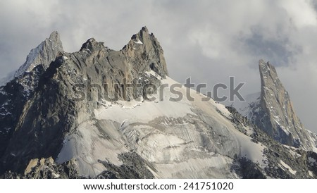 the Aiguille du Tacul foreground, and the Dent du Geant (right) in the Mont Blanc Massif above Chamonix in France                            - stock photo