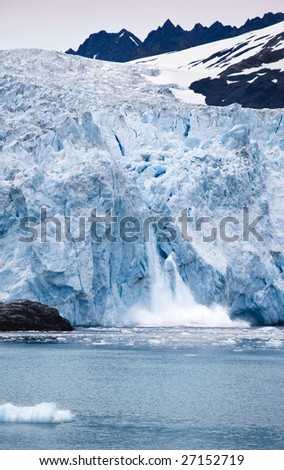 The Ailiak glacier calves ice into the Bay of Alaska - stock photo