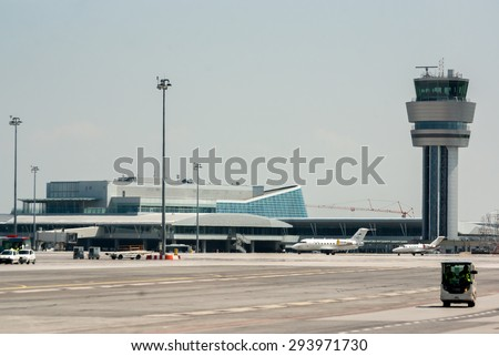 The aircontrol tower and the passenger Terminal 2 of Sofia airport in Sofia, Bulgaria, April 22, 2014.  - stock photo