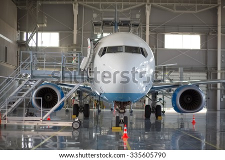 the aircraft in the hangar - stock photo
