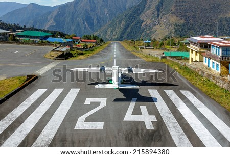 The aircraft on the runway of the Tenzing-Hillary airport Lukla - Nepal, Himalayas - stock photo