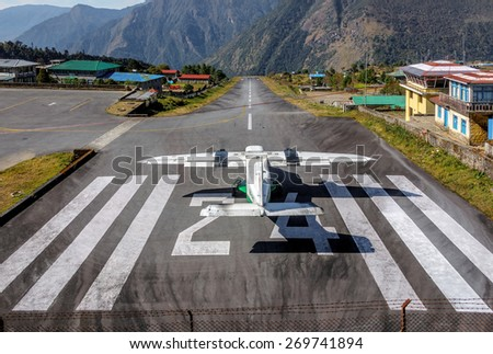 The aircraft on the runway of the Tenzing-Hillary airport Lukla village- Nepal, Himalayas - stock photo