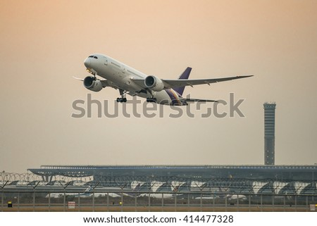 The aircraft was flying during sunrise. - stock photo