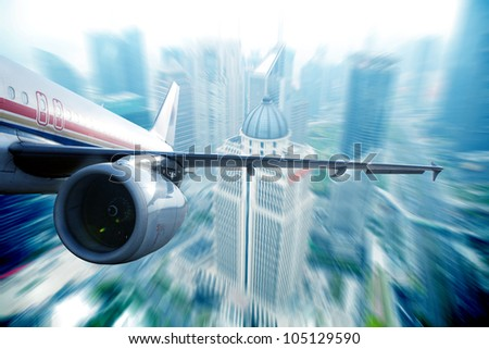 the airplane away from the city,abstract background - stock photo