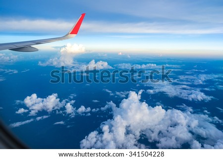 the airplane is taking off over Chiang mai city - stock photo