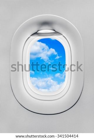the airplane porthole - stock photo
