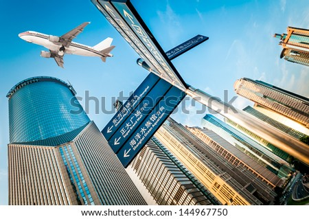 the airplane with the city scene background in Shanghai China - stock photo