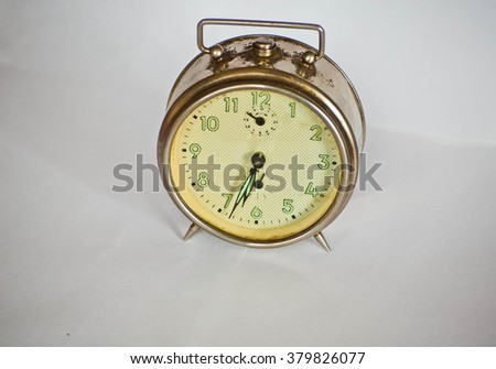The alarm clock on white background