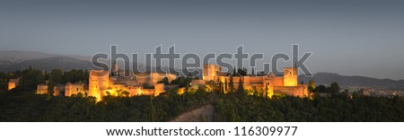 The Alhambra, in Granada, Spain at twilight. Evening panorama