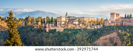 The Alhambra is a palace and fortress complex located on the left bank of the river Darro in Granada, Andalusia, Spain. It was built with influences of Arabic and Renaissance  styles. - stock photo
