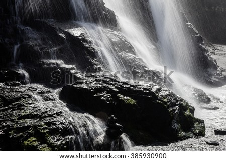 The Alomere waterfall drops from a cliff to the beach along the coast of northern California. This is one of the bay areas most beautiful hikes and is found in Point Reyes National Seashore. - stock photo