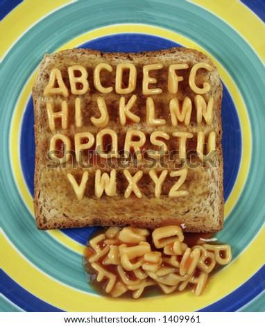 the alphabet written with pasta shapes on toast - stock photo