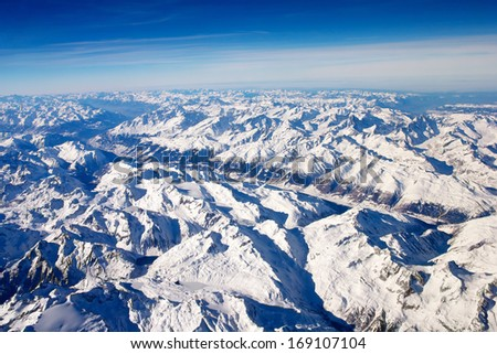 The Alps in winter out of areal view with manuel focus - stock photo