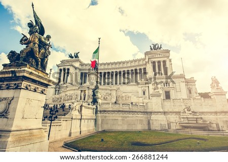 "The Altare della Patria (Altar of the Fatherland) also known as  ""Il Vittoriano"" with tourists. it is one of the main tourist attractions in Rome. - stock photo"