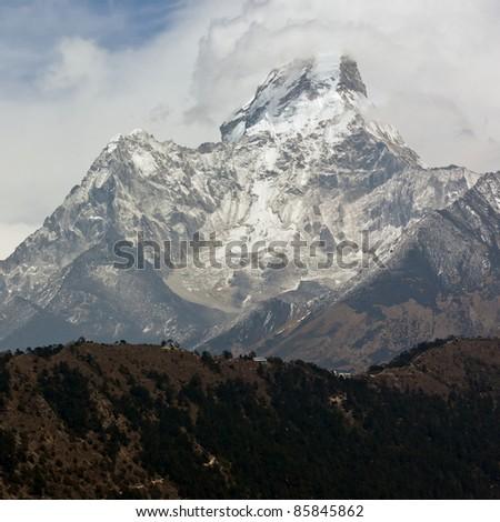The Ama Dablam peak to the mountains.in bad weather - Nepal - stock photo