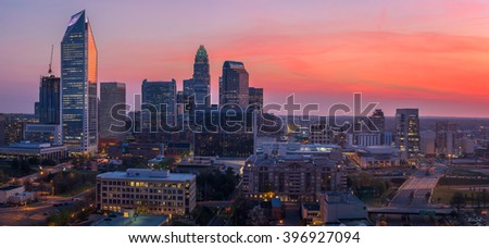 The amazing and colorful sky in Uptown Charlotte, North Carolina right before sunrise on a beautiful spring morning.  - stock photo