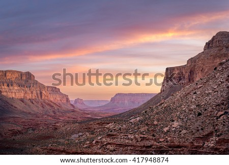 The amazing colors of sunrise while backpacking through the southwestern Arizona desert on the way to Havasu Falls.  - stock photo