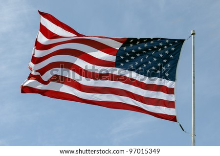 The American Flag Flowing In The Wind - stock photo