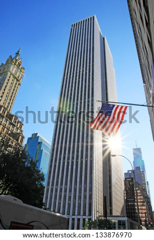 The american flag on the wind in a sunny day - stock photo