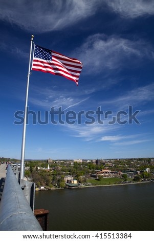 The American flag proudly flies over the Hudson River