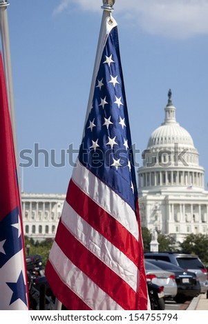 The American flag with the US Capitol in the background.