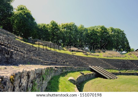 The amphitheatre of Autun. Emperor Augustus built this largest Roman Amphitheatre of its time, seating up to 20,000 spectators and the remains can still be seen today. - stock photo