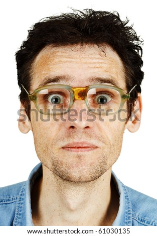 The amusing tousled man in old ridiculous spectacles isolated on white - stock photo