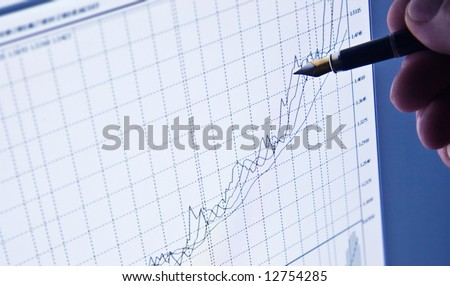 The analysis of the chart on the screen of a computer - stock photo