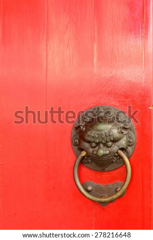 The ancient Chinese dragon head door. - stock photo
