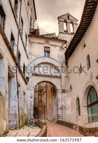 "the ancient city gate ""Porta Fuga"" in the medieval town Spoleto, Umbria , Italy"