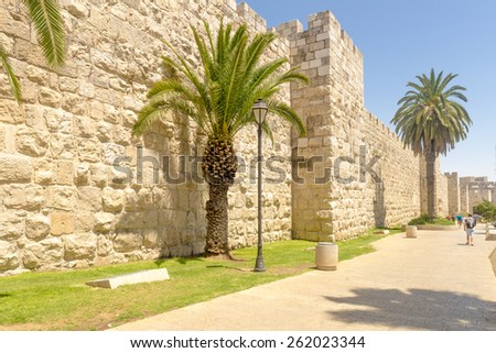 The ancient city walls and towers in the old Jerusalem - stock photo
