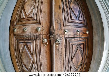 The ancient door in the courtyard of the Nuruosmaniye Mosque in Istanbul, Turkey - stock photo