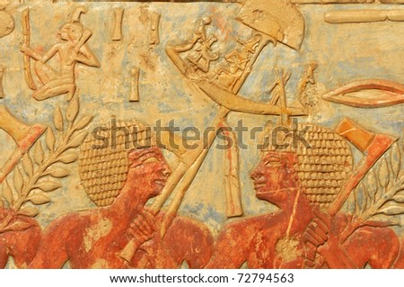 The ancient egyptian army. A standard bearer turns and talks to a fellow axeman - stock photo