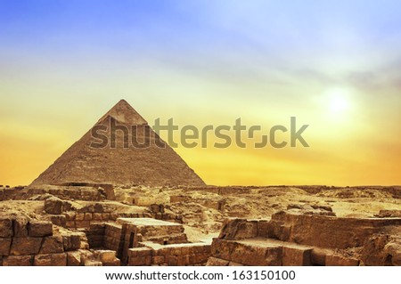 The Ancient Egyptian Famous Pyramid of Giza at Sunset - stock photo