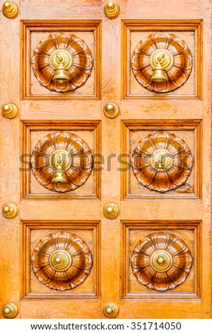 The Ancient knocker of style on background. - stock photo