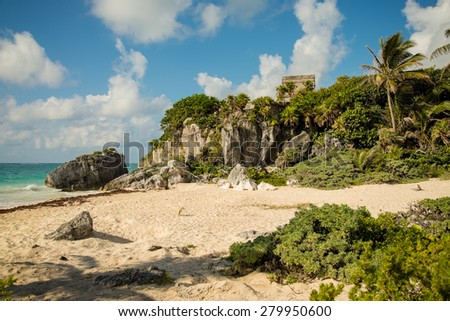 The ancient Mayan ruins in Tulum, Mexico on a beautiful blue sky day - stock photo